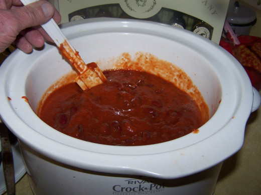 Stir together the sauce and the chili beans.