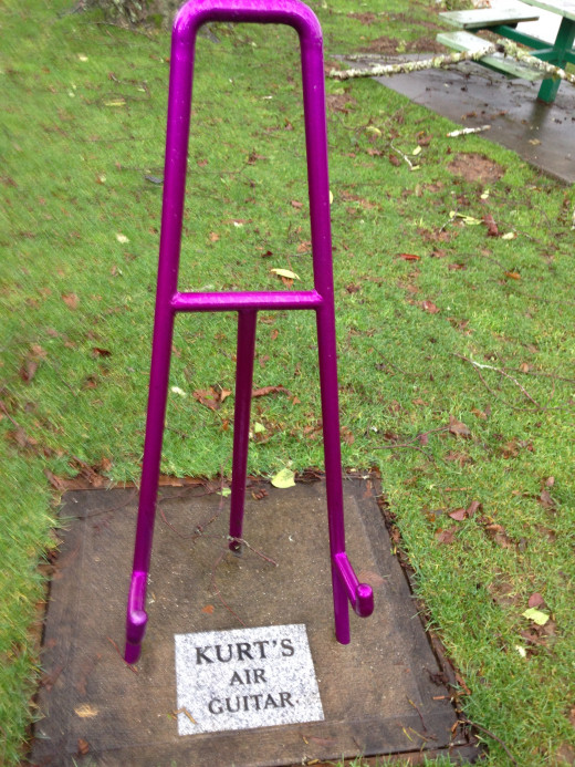 "This is Kurt Cobain's ""Air Guitar"" a kind of humorous imaginary guitar stand that rests in the grass of Kurt's Riverside Park."