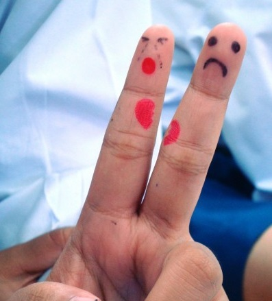 Unhappy male and female finger puppets by: Ian L