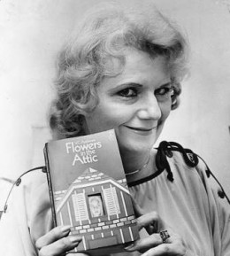 Cleo Virginia Andrews posing with her infamous novel, Flowers in the Attic.