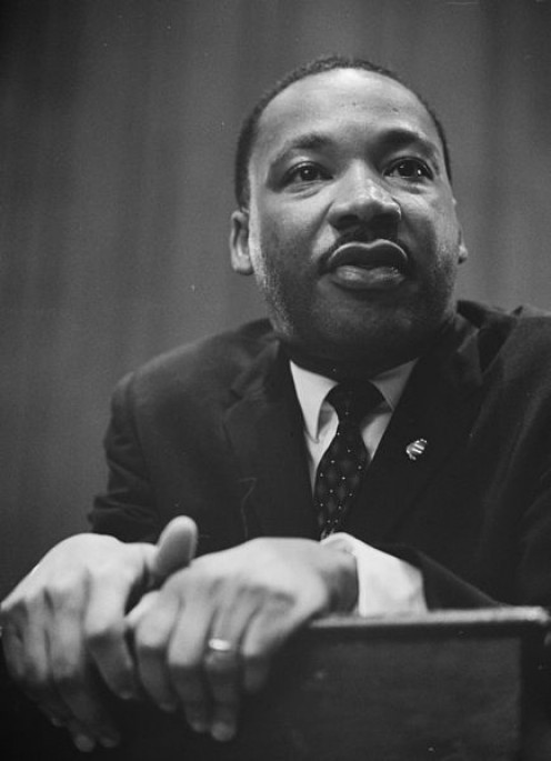 Martin Luther King Jr. - Leaning on a lectern in 1964.  Photo taken by Trikosko, Marion S., and in the public domain.