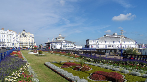 The green alongside Grand Parade, Eastbourne, East Sussex, on a sunny day