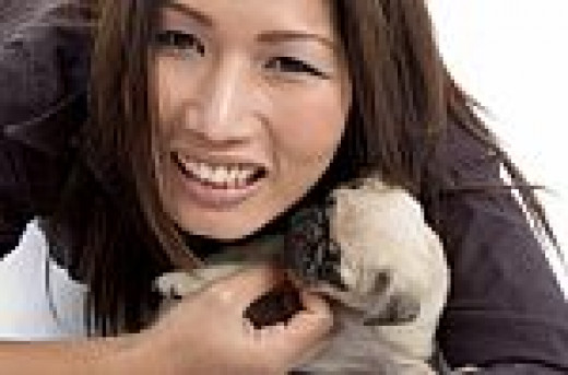 Smiling Female with Little Puppy