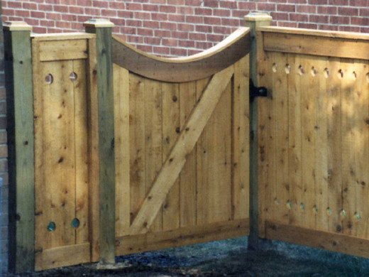 Fence details, such as the post tops, and especially custom gates like this one, can really make a Fence stand out!
