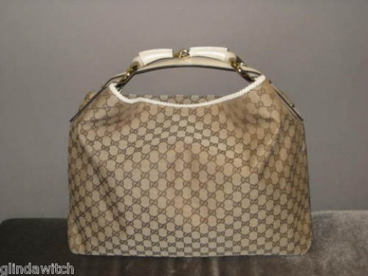 Just a view of an authentic large Gucci Chain hobo style # 114900