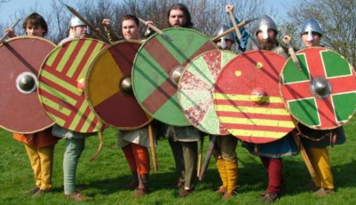Harold's warriors struck the backs of their shields loudly with their weapons, calling out 'Ut, ut, ut! at William and his allies, 'Out,out, out!' The call was carried through the ranks, creating a din loudly enough to startle the Normans' mounts