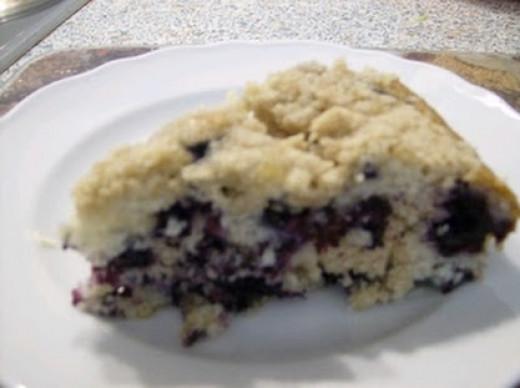 Slice of gluten free wild blueberry coffee cake.