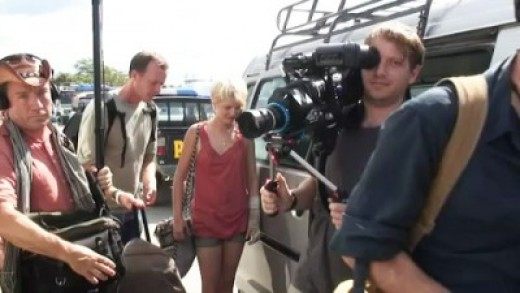 Gareth Edwards (with camera),  Whitney Able, (center), Scoot McNairy (at right edge), and some of his crew shooting Monsters
