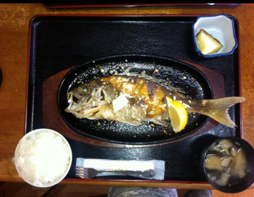 Yakizakana means grilled fish. Many varieties of fish are cooked in this fashion.