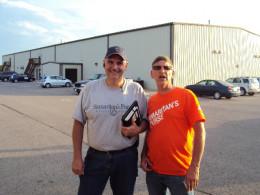 Tony McNeil director in Shawnee, Ok for Samaritan's Purse in grey shirt myself in orange shirt.
