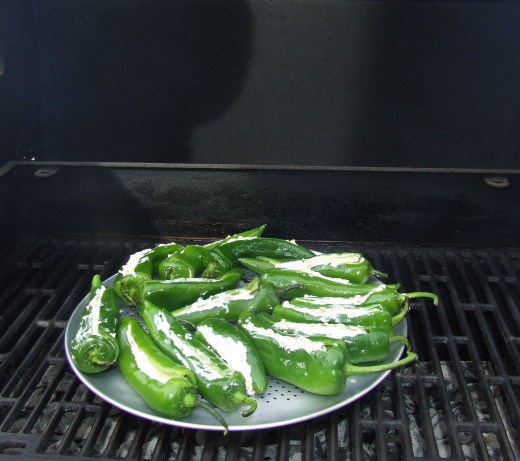 Stuffed AnaheimPeppers placed on the grill.