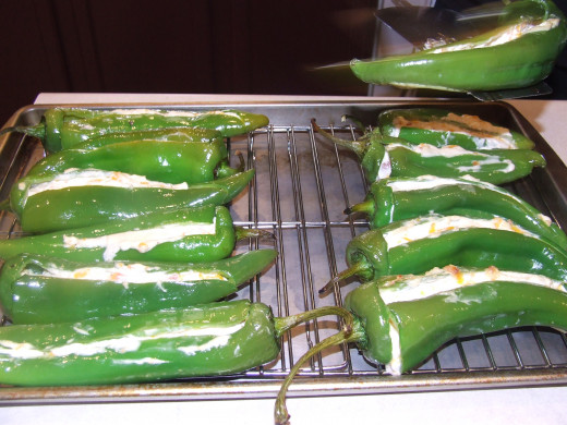 Afterwards the peppers are removed form the grill and placed on a cooling tray.