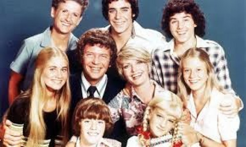 The Brady Bunch was aired from 1969-1974. Husband, wife, six kids and a maid. Wow.