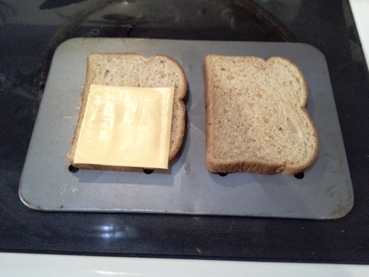 Step Three: Lay out your cheese slices on one side of sandwich