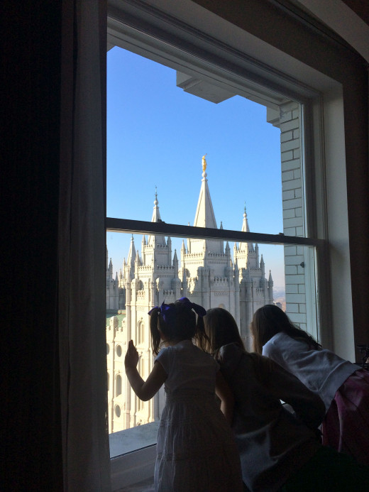 Some of our grandchildren looking out of the window of the Joseph Smith Memorial Building towards the Salt Lake City Temple.