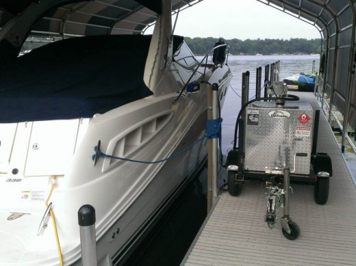 Shown here is a gas trailer being used to refuel a boat.