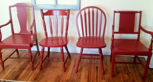 I bought this set of four eclectic chairs for $5 each spray painted them red and sold the set of four four $100