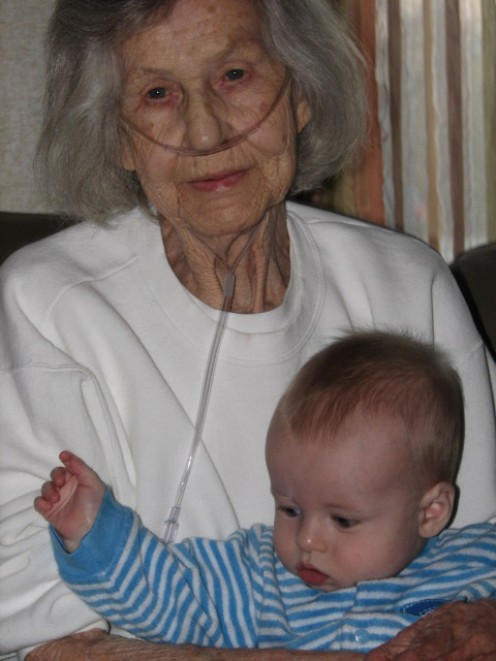 Holding Her First Great Grand Child With Love Her Eyes Speak For Themselves.
