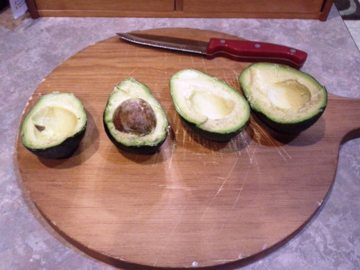 Step Two: Cut avocados in half and remove pits