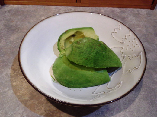 Step Four: Place your avocado halves in a small bowl