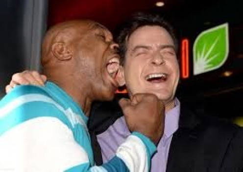 Mike Tyson, seen here biting at Charlie Sheen, has turned into a loved, mainstream celebrity. He  was one of the roasters on the Comedy Central Roast of Charlie Sheen.