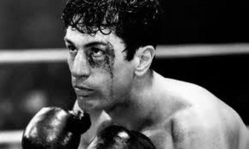 Raging Bull stars Robert De Niro and Joe Pesci. De Niro portrays real life boxer Jake La Motta and Joe Pesci plays his brother.