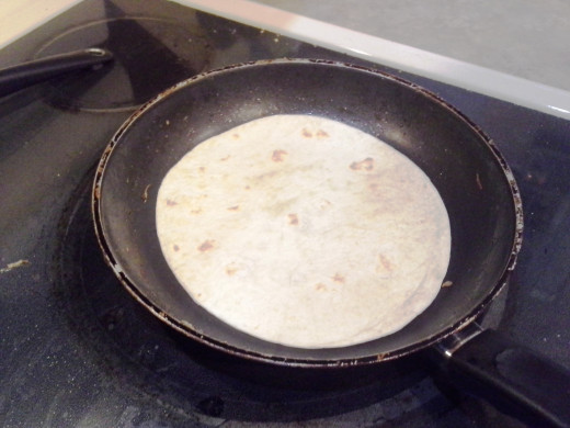 Step Ten: Lay out a tortilla in your chicken pan