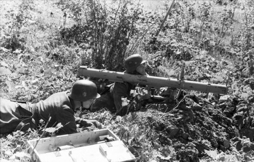 "Estonian soldiers of the 20th Waffen Grenadier Division of the SS (1st Estonian) with a Panzerschreck (""Stovepipe"") anti-tank weapon. August 1944."