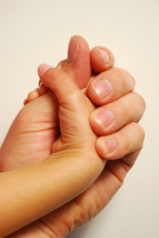 Fathers should hold their daughters' hands to show them how much they love them. Physical touch conveys love.
