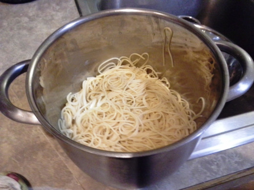 Step Twelve: Pour your pasta back into the pot it cooked in