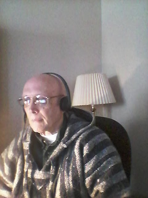 Self-portrait photo of Brian Leekley wearing the Logitech headset with which he dictates to Dragon Naturally Speaking
