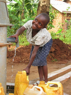 Outdoor spigot provides groundwater for village children in Uganda.