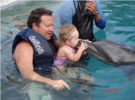 Dolphin therapy is believed to have a therapeutic effect on children with Down syndrome. While it is not a cure, Dolphin therapy can enhance their healing process. Image used with permission of Patricia Ann Talley, editor of imagine-mexico.com