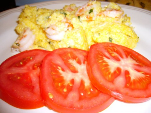 Serve your Shrimp and Grits Casserole with Sliced Tomatoes for a tasty combination.