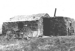 A sod house on the American prairie, photo taken in 1901