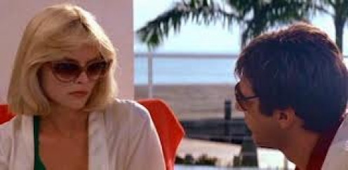 Michelle Pfeifer and Al Pacino star in Scarface. They have great chemistry in this film. They are like the modern day Bonnie & Clyde.