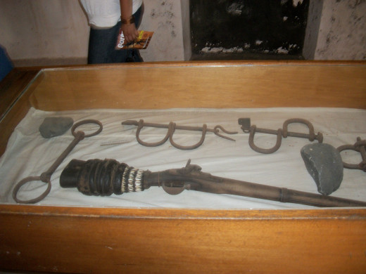 My picture taken regarding the chains and guns used to move Africans from Africa to America.
