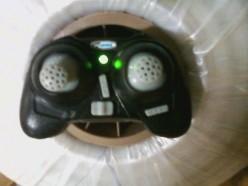 Mini quadcopter with remote control unit.