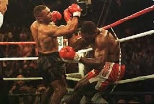 Mike Tyson rips an uppercut into England's Frank Bruno in their 1995 rematch.