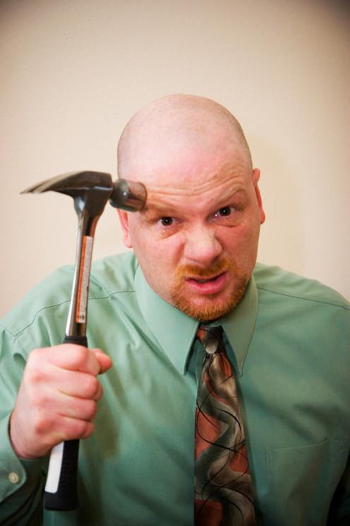 A man holding a hammer.