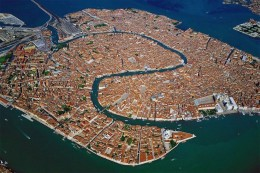 Venice, a city sited on a group of 118 small islands separated by canals and linked by bridges as seen from above.