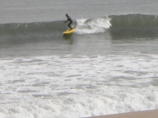 Catching a wave in the Carolina Beach surf.