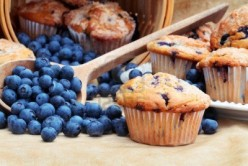 Blueberries and Blueberries Muffins. Here is a picture of blueberries and blueberry muffins that you can eat the muffins and either just eat the raw blue berries and you can cook with them.