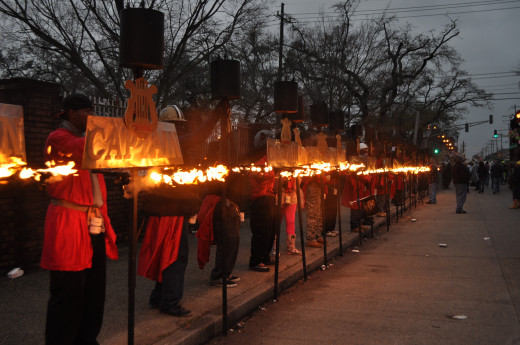 All the flambeaux alight. These are traditional for night parades from before there were streetlights to show the way