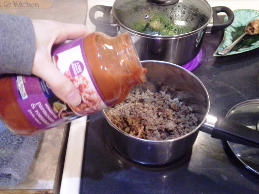 Step Eight: Add in your pasta sauce to your hamburger in the sauce pot