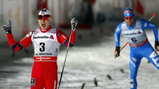 Finn Haagen Krogh of Norway reacts in front of Italy's Frederico Pellegrino (R) after winning the World Cup men's cross country sprint race