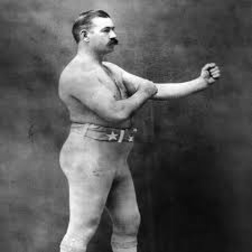John L. Sullivan also known as The Boston Strong Boy was the last bare knuckle heavyweight champion and the first ever boxing (gloves) heavyweight champion as well.