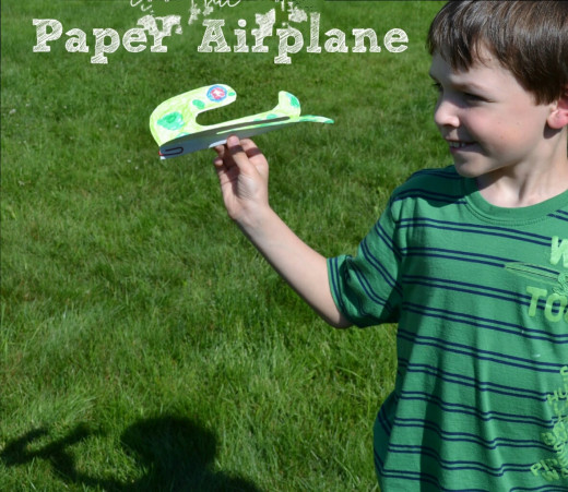 A paper airplane signifies a little boy's dream.