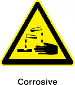 Hazard signage for corrosive materials