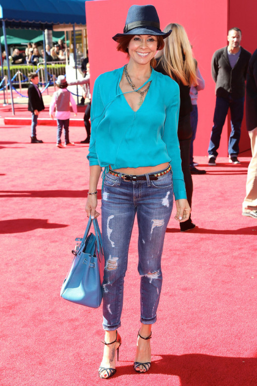 Brooke Burke in distressed jeans and heels